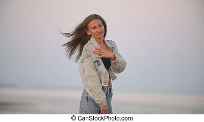 girl in jeans clothes on a background of the sea - girl with...