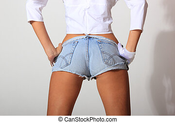 girl in jeans shorts over neutral background