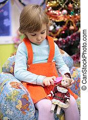 girl in kindergarten with doll