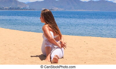 girl in lace shows yoga asana twisting with hands behind back