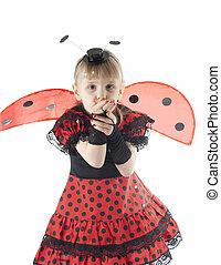 Girl in ladybug costume on white background