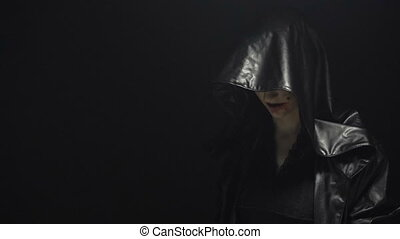 Girl in leather black hood - Footage of woman during ritual...
