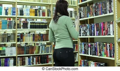 Girl In Library Looking For A Book