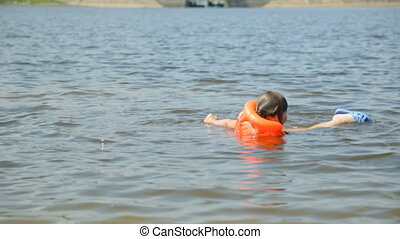 Girl in life jacket in water