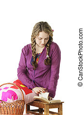 Girl in lilac shirt reading book