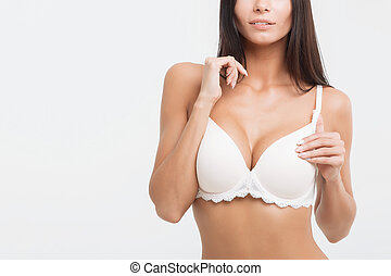 Girl in lingerie on white background