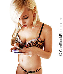 Girl in lingerie texting. - A young woman in brown lingerie...