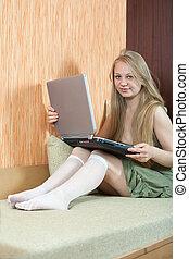 Girl in livingroom with laptop