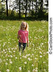 girl in meadow dandelion