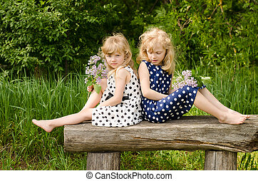 girl in meadow on bench