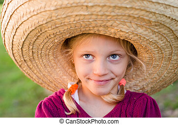 girl in Mexican hat