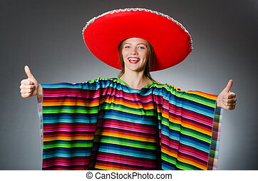 Girl in mexican vivid poncho against gray