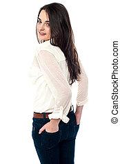 Girl in modern attire looking sideways