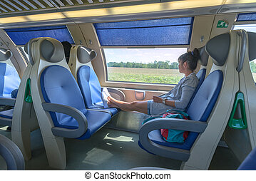 train - girl in modern train closeup