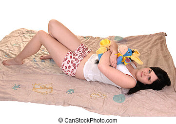 Girl in nightwear. - A young pretty woman lying on her...