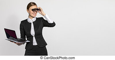 girl in office suit looking through binoculars