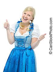 girl in oktoberfest dirndl shows thumbs up