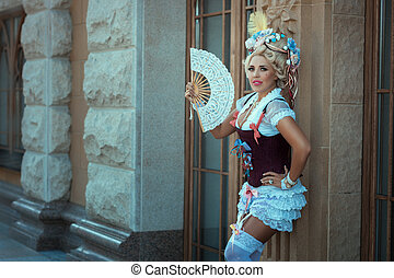 Girl in old clothes and vintage hair on his head.