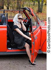 girl in old retro car