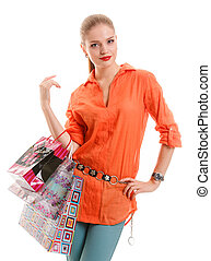 girl in orange shirt with shopping bags on an isolated backgroun