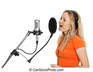 Female singer in orange t-shirt singing with studio microphone. Isolated on white background.
