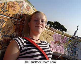 girl in park guell - girl on the big bench in antoni gaudi's...