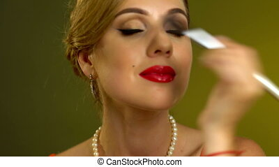 Girl in pin up retro style make make up.