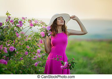 Girl in pink dress and vintage Cap