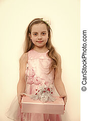 Girl in pink dress with long blond hair