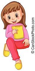Girl in pink pajamas eating snack