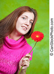 girl in pink with red flower