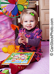 Girl in playing room with puzzle