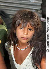 Girl in Poverty - A portrait of a ver poor Indian girl