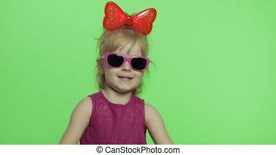 Girl in purple dress. Dancing and shows a finger forward. Chroma Key