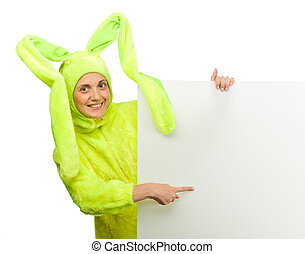 Girl in rabbit costume point to the blank board