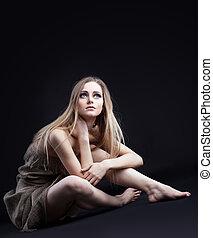 girl in rag from dark look at light