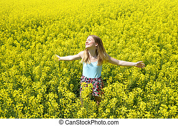girl in rapeseed field - Young happy woman on blooming ...