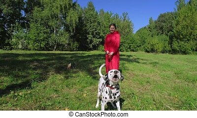 girl in red cloak walking her dogs in the Park