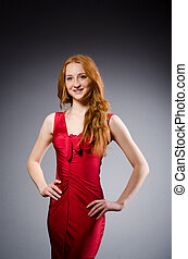 Girl in red dress against gray