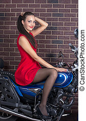 Girl in red dress on a motorcycle