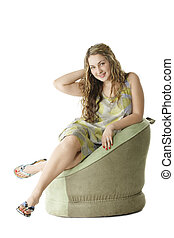 Girl in red dress sitting in chair