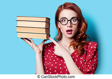 girl in red dress with books - Young redhead teacher in red...