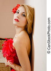 Girl in red dress with flower barrette and feather boa -...