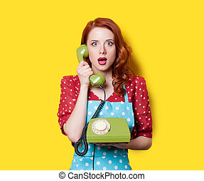 girl in red dress with green dial phone - Surprised redhead...