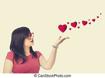 girl in red glasses and abstract hearts at white background.