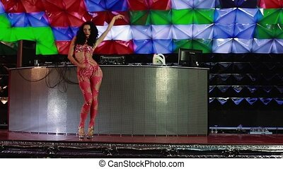 Girl in red is dancing on stage