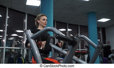 Girl in red leggings in the gym