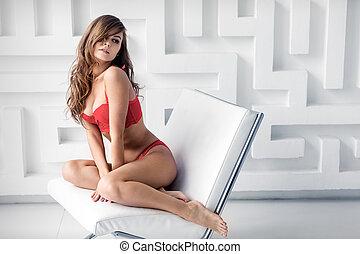 girl in red lingerie sitting