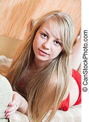 girl in red lying on sofa