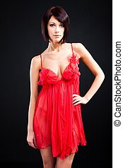 girl in red nightgown on black background